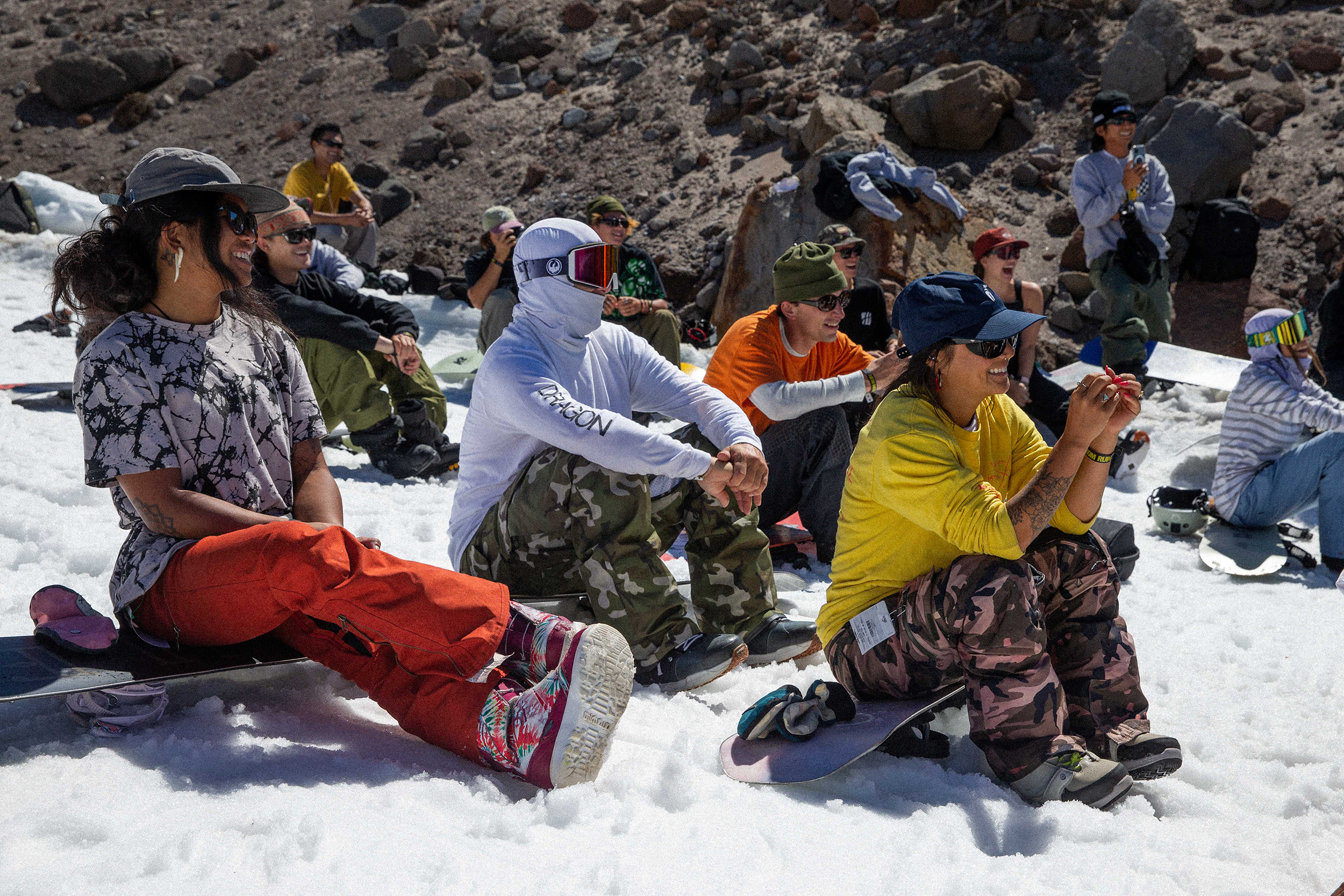 snowboarders hang out together